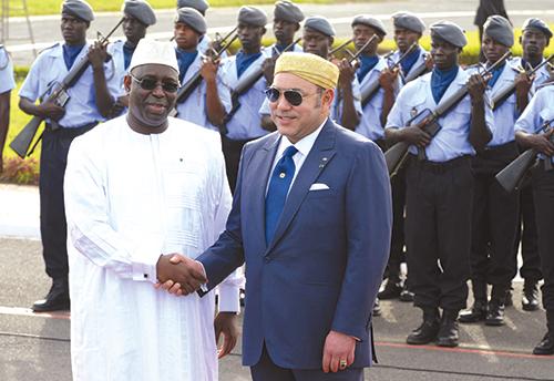 S.M. Mohammed VI et Le président sénégalais Macky Sall . Dakar, le 15 mars 2013. - © Ph : AFP